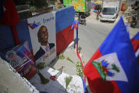 A freshly painted mural of late President Jovenel Moise covers a wall in the Kenscoff neighborhood of Port-au-Prince Haiti, Wednesday, July 21, 2021. Moise was assassinated on July 7. (AP Photo/Joseph Odelyn)