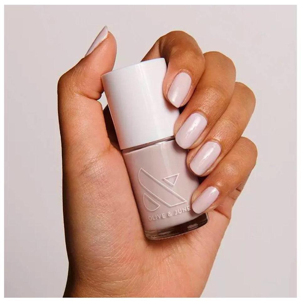 """I am devoted to Olive & June's incredible range of neutrals, and particularly love this almond-toned color in the summertime. The low-maintenance color lasts for two weeks—and, bonus, doesn't look overtly unkempt once it does start to chip. <em>—Deanna Pai, acting commerce editor</em> $10, Target. <a href=""""https://www.target.com/p/olive-38-june-nail-polish-0-46-fl-oz/-/A-79576361"""" rel=""""nofollow noopener"""" target=""""_blank"""" data-ylk=""""slk:Get it now!"""" class=""""link rapid-noclick-resp"""">Get it now!</a>"""