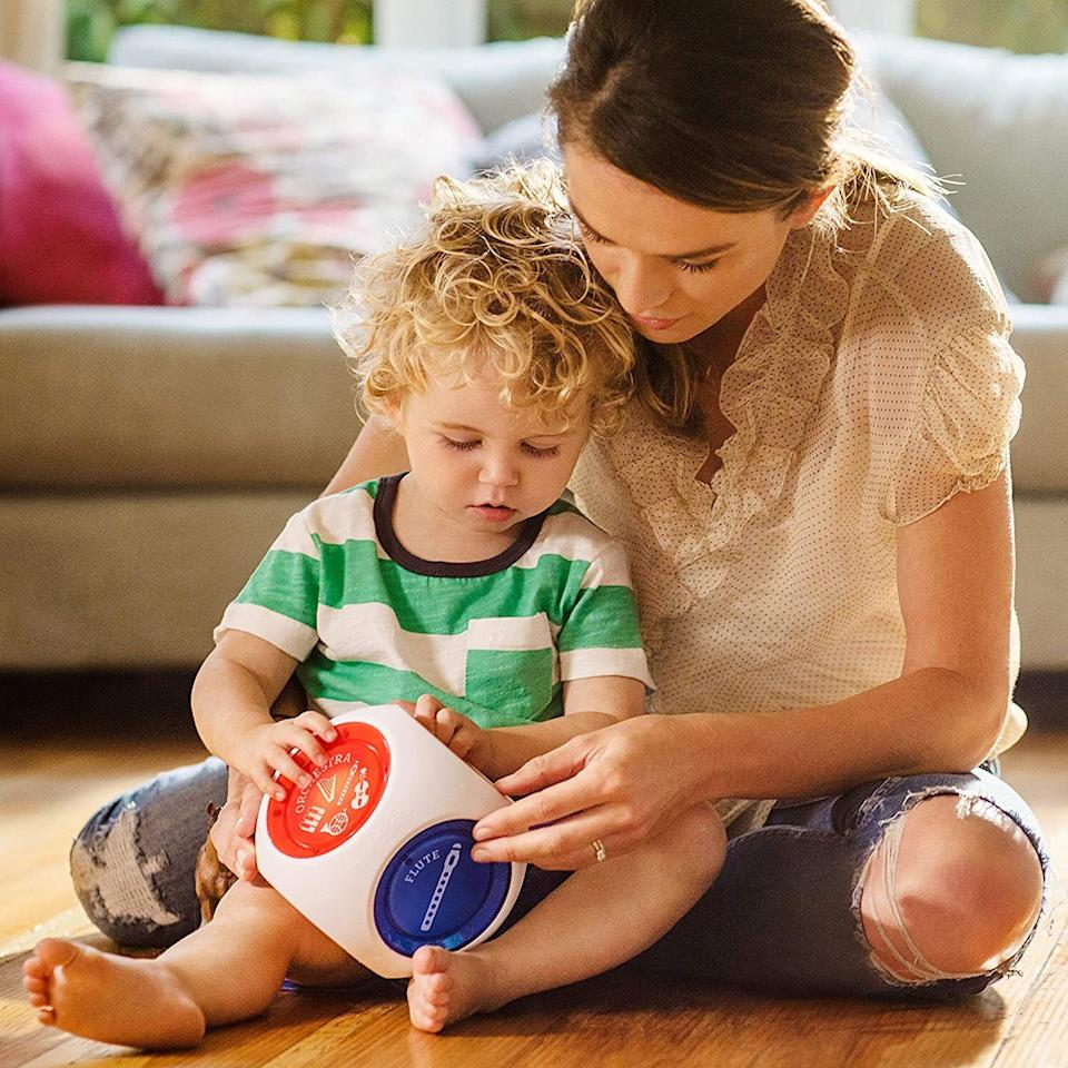 """Your kiddies can compose and remix some of Mozart's classical music masterpieces. It's baby's first beats lab but, like, totally classy.<br /><br /><strong>Promising review:</strong>""""My son plays with it for up to 15 minutes many times a day. I never get sick of the songs. Like another reviewer said, it's the perfect size for the baby to use as a counterbalance while learning to sit up. Every baby/parent needs this toy. If they came out with another cube with new songs/instruments I would buy it in a heartbeat!"""" —<a href=""""https://amzn.to/3xjiyQA"""" target=""""_blank"""" rel=""""noopener noreferrer"""">Kevin</a><br /><strong><br />Get it from Amazon for<a href=""""https://amzn.to/3sG9stJ"""" target=""""_blank"""" rel=""""noopener noreferrer"""">$24.49</a>.</strong>"""