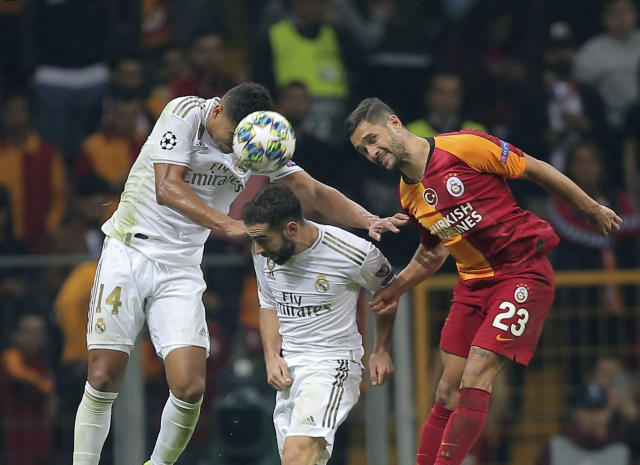 Galatasaray's Florin Andone, right, jumps for the ball with Real Madrid's Casemiro, left, and Real Madrid's Dani Carvajal during the Champions League group A soccer match between Galatasaray and Real Madrid in Istanbul, Tuesday, Oct. 22, 2019. (AP Photo)