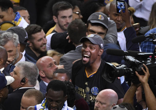 <p>Golden State Warriors forward Kevin Durant celebrates after defeating the Cleveland Cavaliers in game five of the 2017 NBA Finals at Oracle Arena. Mandatory Credit: Kyle Terada-USA TODAY Sports </p>