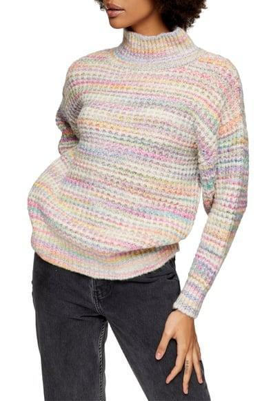 <p>The rainbow-inspired motif on this <span>Topshop Space Dye Chunky Turtleneck Sweater</span> ($45, originally $75) is perfect.</p>