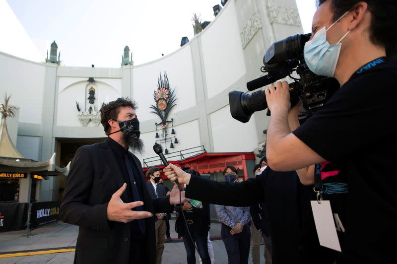 """Adam Wingard, director of the upcoming movie """"Godzilla vs. Kong"""", is interviewed at a ribbon cutting ceremony ahead of the reopening of the TCL Chinese theatre during the outbreak of the coronavirus disease (COVID-19), in Los Angeles"""