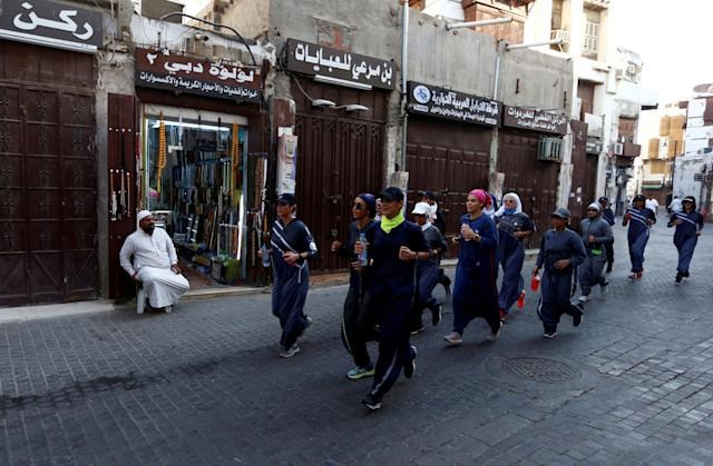 <p>Women run during an event marking International Women's Day in Old Jeddah, Saudi Arabia, March 8, 2018. (Photo: Faisal Al Nasser/Reuters) </p>