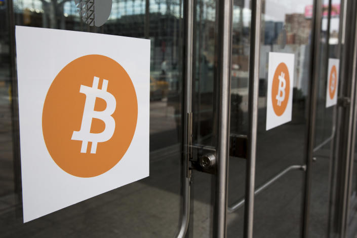 Bitcoin themed stickers stand attached to glass doors during the Inside Bitcoins: The Future of Virtual Currency Conference in New York April 8, 2014. REUTERS/Lucas Jackson (UNITED STATES - Tags: BUSINESS SCIENCE TECHNOLOGY)