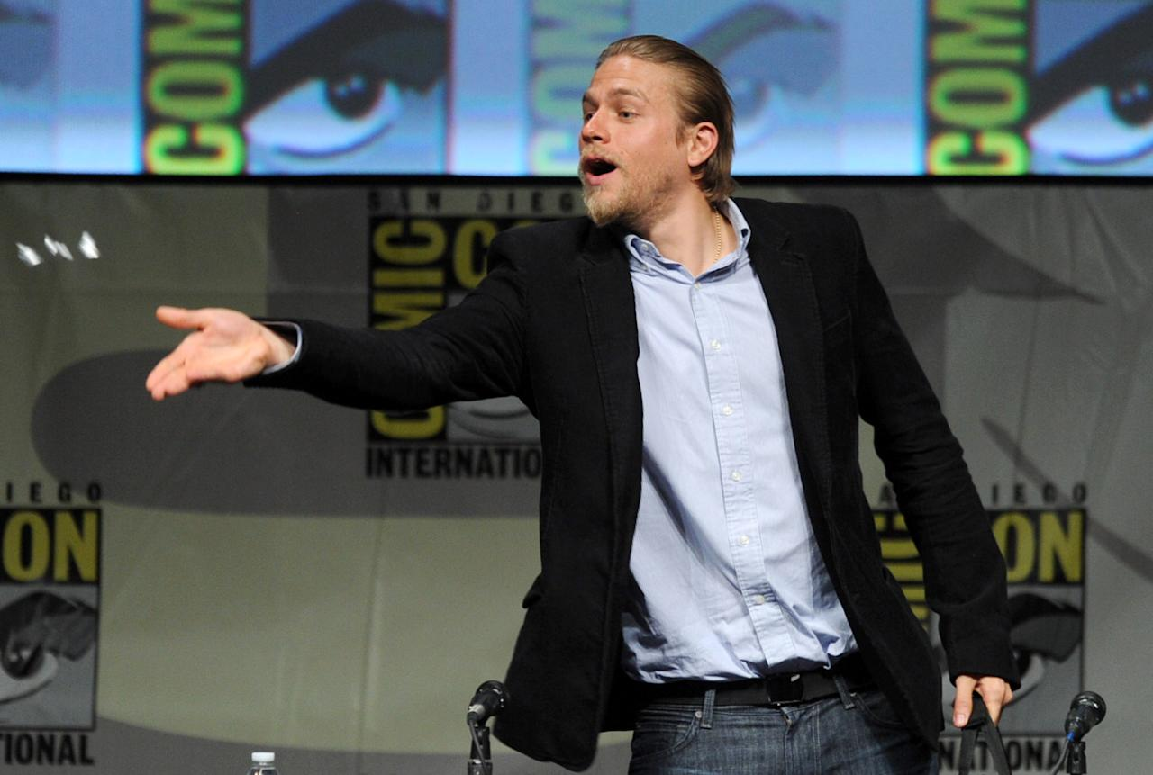 "SAN DIEGO, CA - JULY 14:  Actor Charlie Hunnam speaks at Warner Bros. Pictures and Legendary Pictures Preview of ""Pacific Rim"" during Comic-Con International 2012 at San Diego Convention Center on July 14, 2012 in San Diego, California.  (Photo by Kevin Winter/Getty Images)"