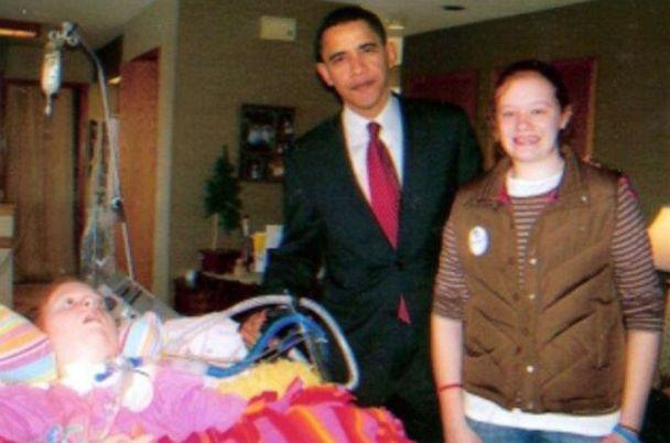 PHOTO: Then-presidential candidate Barack Obama poses for a photo with Alex, left, and Jaci Hermstad during a surprise visit to the family home in Storm Lake, Iowa in 2008. (Courtesy Lori Hermstad)