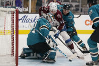San Jose Sharks goaltender Martin Jones (31) defends on a shot by Colorado Avalanche left wing Gabriel Landeskog (92) during the second period of an NHL hockey game in San Jose, Calif., Wednesday, March 3, 2021. (AP Photo/Jeff Chiu)