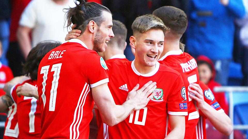 Pictured here, Wales star David Brooks and teammate Gareth Bale embrace during a game.