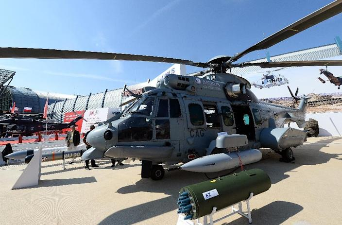 File photo shows a multi-role Airbus Helicopters EC 725 military helicopter at an international military fair in Kielce, Poland on September 4, 2014 (AFP Photo/Janek Skarzynski)