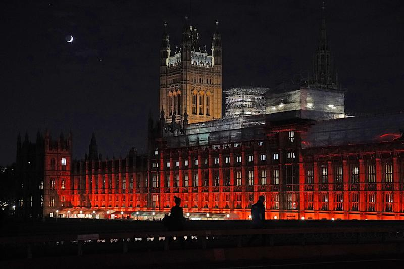 The Houses of Parliament were floodlit in red to remember all those killed, kidnapped, tortured or suffering because of their religious beliefs. The #RedWednesday campaign isorganizedby the charity Aid to the Church in Need. (Christopher Furlong via Getty Images)