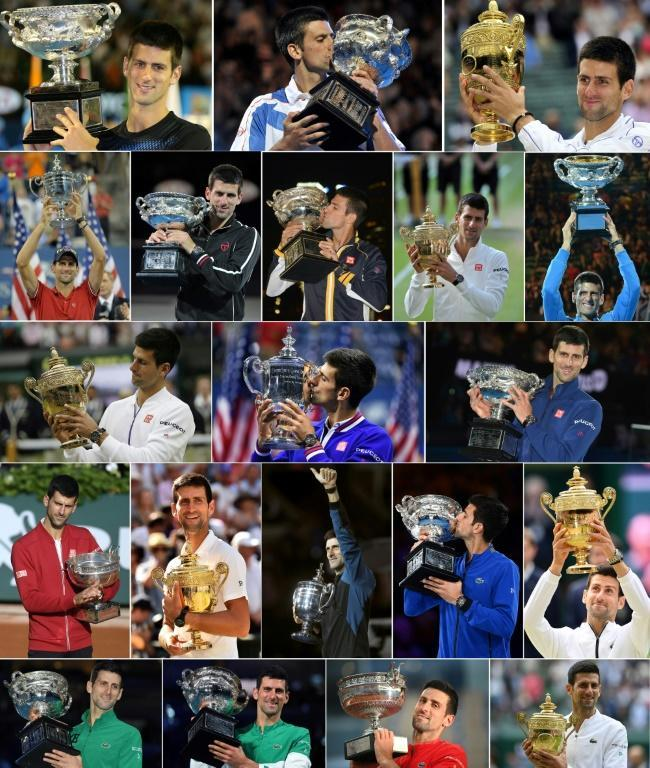 Grand Slam collection: Novak Djokovic poses with the trophies after his 20 Grand Slam final wins