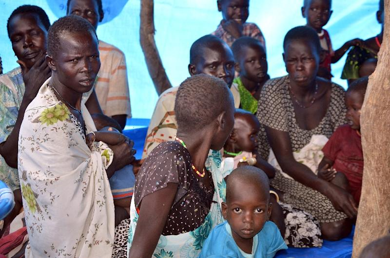 Anger is growing at the humanitarian toll exacted by South Sudan's 15-month conflict which has killed tens of thousands and left millions dependent on aid, like these women and children pictured on March 21 in Ganyiel village, Panyijar County of Unity State (AFP Photo/Samir Bol)