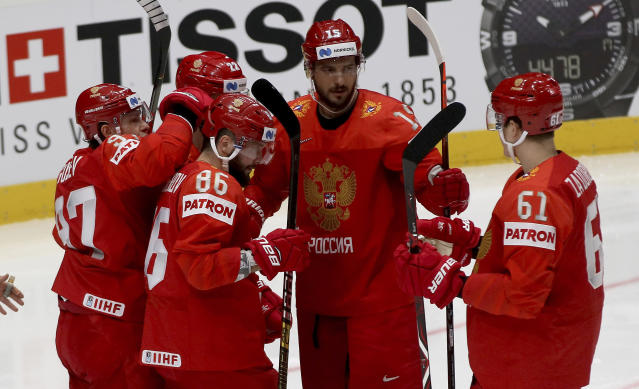 Russia's players react after scoring during the Ice Hockey World Championships group B match between Russia and Italy at the Ondrej Nepela Arena in Bratislava, Slovakia, Wednesday, May 15, 2019. (AP Photo/Ronald Zak)