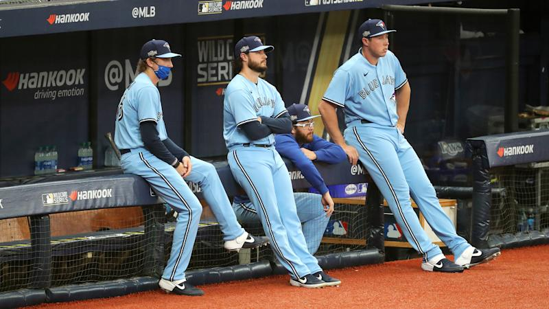 ST. PETERSBURG, FL - SEPTEMBER 30: Ryan Borucki #56, Thomas Hatch #31, Anthony Kay #47 and Nate Pearson #24 of the Toronto Blue Jays look on from the dugout during Game 2 of the Wild Card Series between the Toronto Blue Jays and the Tampa Bay Rays at Tropicana Field on Wednesday, September 30, 2020 in St. Petersburg, Florida. (Photo by Mike Carlson/MLB Photos via Getty Images)