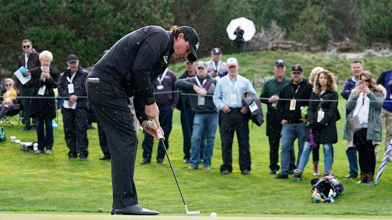 Mickelson leads at Pebble Beach as play suspended again