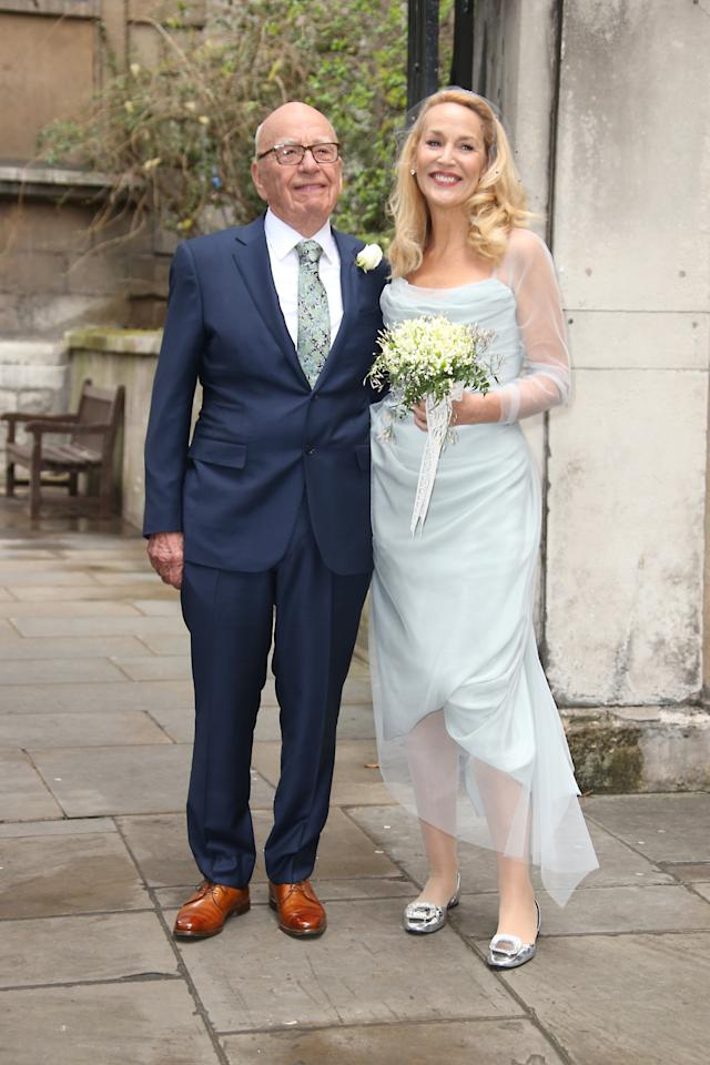 """<p>Just four months after meeting for the first time, model Jerry Hall, 59, and Aussie media mogul Rupert Murdoch, 84, tied the knot in London. This being her second wedding (her first was to rock star Mick Jagger in 1990, though it was later annulled), the 6-foot-tall Hall wore a light blue, tea-length dress by her friend Vivienne Westwood and silver Roger Vivier flats. In her curled blond hair was a veiled, flecked fascinator. Meanwhile, billionaire Murdoch matched his fourth bride in a navy suit, pale blue tie, and brown shoes. """"Jerry has simply not stopped smiling,"""" wedding guest and former Rolling Stones bassist <a href=""""http://www.dailymail.co.uk/news/article-3479995/Rupert-Murdoch-s-wife-Wendi-Deng-heads-Paris-Fashion-Week-billionaire-tycoon-married-Jerry-Hall.html"""">Bill Wyman said of Hall</a>. """"She was ecstatic — they both were — it was a fantastic service.""""<i>(Photo: AP Images)</i></p><p><i><b><br /></b></i></p><p><i><b><br /></b></i></p>"""