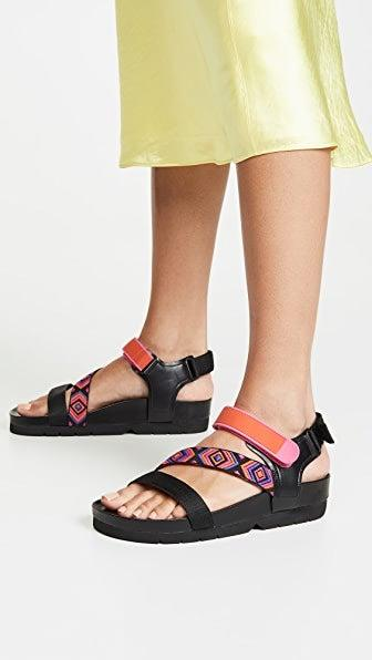 """<h2>Shopbop</h2><br><strong>Deal</strong>: <strong>Up To 70% Off</strong><br>With a frequently refreshed up to 70% off clearance section, Shopbop's in-season sale-sandal offerings are ripe for the carting — with must-have styles from the likes of <a href=""""https://www.shopbop.com/marileide-sandal-schutz/vp/v=1/1517519924.htm"""" rel=""""nofollow noopener"""" target=""""_blank"""" data-ylk=""""slk:Schutz"""" class=""""link rapid-noclick-resp"""">Schutz</a>, <a href=""""https://www.shopbop.com/kaia-sandal-by-far/vp/v=1/1576951028.htm"""" rel=""""nofollow noopener"""" target=""""_blank"""" data-ylk=""""slk:BY FAR"""" class=""""link rapid-noclick-resp"""">BY FAR</a>, <a href=""""https://www.shopbop.com/clio-heel-cult-gaia/vp/v=1/1511781073.htm"""" rel=""""nofollow noopener"""" target=""""_blank"""" data-ylk=""""slk:Cult Gaia"""" class=""""link rapid-noclick-resp"""">Cult Gaia</a>, <a href=""""https://www.shopbop.com/darby-heel-sandal-ulla-johnson/vp/v=1/1584339603.htm"""" rel=""""nofollow noopener"""" target=""""_blank"""" data-ylk=""""slk:Ulla Johnson"""" class=""""link rapid-noclick-resp"""">Ulla Johnson</a>, <a href=""""https://www.shopbop.com/les-sandales-raphia-jacquemus/vp/v=1/1593617027.htm"""" rel=""""nofollow noopener"""" target=""""_blank"""" data-ylk=""""slk:Jacquemus"""" class=""""link rapid-noclick-resp"""">Jacquemus</a>, and many more. <br><br><em>Shop <strong><a href=""""https://www.shopbop.com/sale-shoes-sandals/br/v=1/15574.htm"""" rel=""""nofollow noopener"""" target=""""_blank"""" data-ylk=""""slk:Shopbop"""" class=""""link rapid-noclick-resp"""">Shopbop</a></strong></em><br><br><strong>Villa Rouge</strong> Elena Sporty Sandals, $, available at <a href=""""https://go.skimresources.com/?id=30283X879131&url=https%3A%2F%2Fwww.shopbop.com%2Felena-sporty-sandal-villa-rouge%2Fvp%2Fv%3D1%2F1508543228.htm"""" rel=""""nofollow noopener"""" target=""""_blank"""" data-ylk=""""slk:Shopbop"""" class=""""link rapid-noclick-resp"""">Shopbop</a>"""