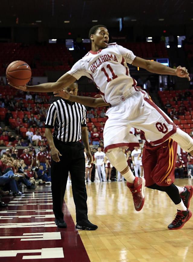 Oklahoma guard Isaiah Cousins goes after a loose ball against Iowa State during the first half of an NCAA college basketball game in Norman, Okla. on Saturday, Jan. 11, 2014. (AP Photo/Alonzo Adams)