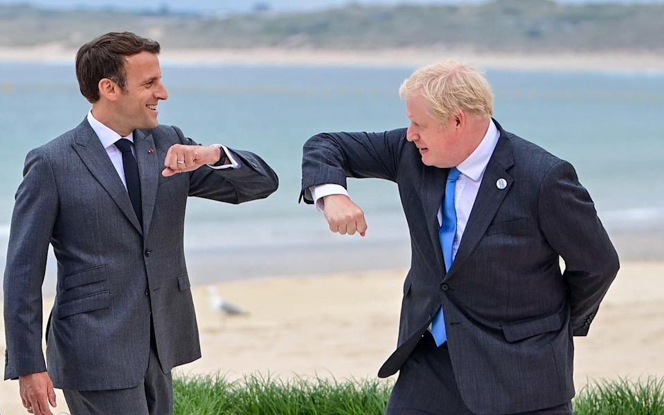 French President Emmanuel Macron elbow bumps with British Prime Minister Boris Johnson on the first day of the G7 leaders summit in Carbis Bay - Neil Hall/EPA