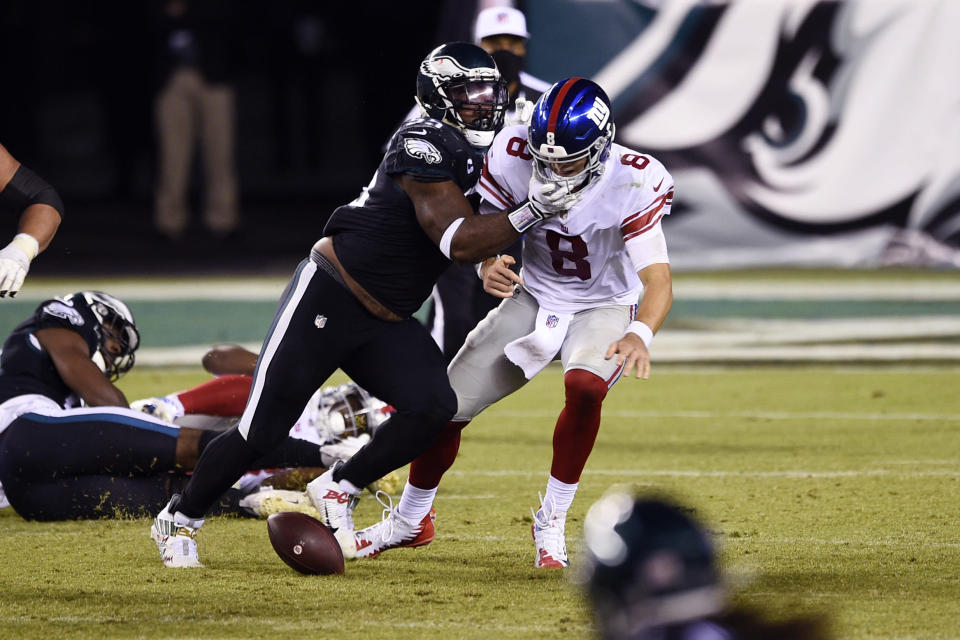 New York Giants' Daniel Jones (8) fumbles after being hit by Philadelphia Eagles' Brandon Graham (55) during the second half of an NFL football game, Thursday, Oct. 22, 2020, in Philadelphia. (AP Photo/Derik Hamilton)