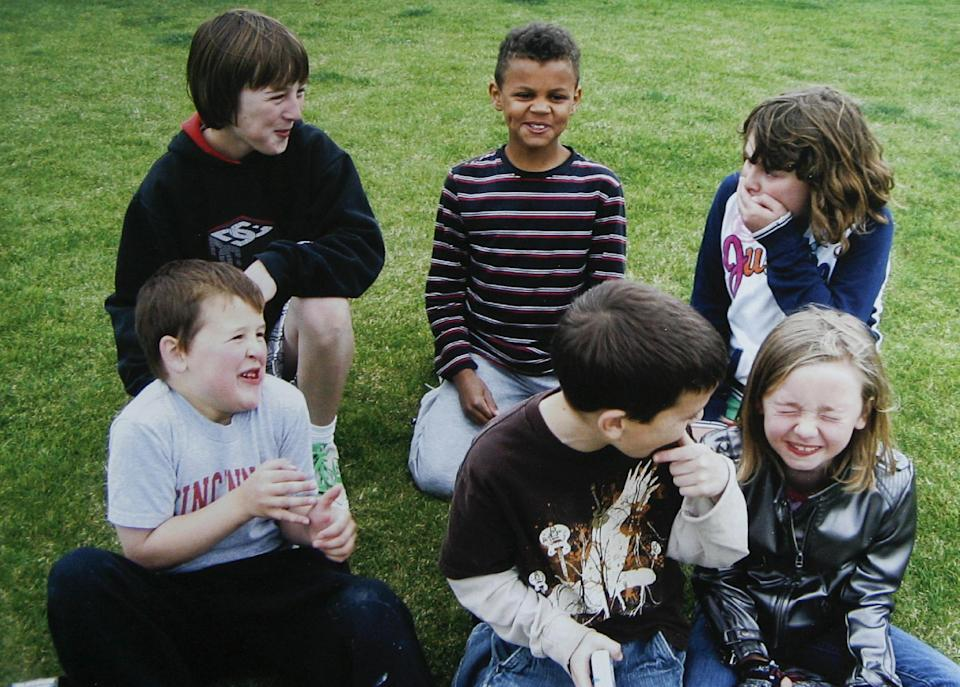 In this 2009 photo provided by the family, Sydnee Neiman, bottom right, laughs with neighborhood friends before her fourth open-heart surgery. Neiman, who suffered from a congenital heart defect and survived four open-heart surgeries, died in late 2011 after her mother, Judy Neiman, accidentally backed over her with her SUV. Although there is a law in place that calls for new manufacturing requirements to improve the visibility behind passenger vehicles, the standards have yet to be mandated because of delays by the U.S. Department of Transportation. (AP Photo/Courtesy of Judy Neiman)