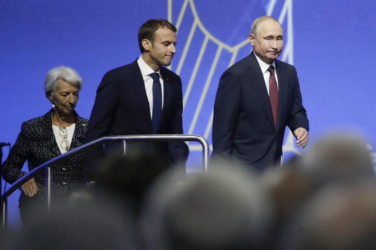 Russian President Vladimir Putin, right, French President Emmanuel Macron, center, and International Monetary Fund (IMF) Managing Director Christine Lagarde arrive to attend the St. Petersburg International Economic Forum in St. Petersburg, Russia, Friday, May 25, 2018. (AP Photo/Dmitri Lovetsky, Pool)