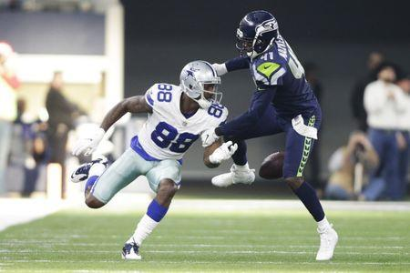 FILE PHOTO: Dec 24, 2017; Arlington, TX, USA; Dallas Cowboys wide receiver Dez Bryant (88) fumbles the ball after being hit by Seattle Seahawks cornerback Byron Maxwell (41) in the second quarter at AT&T Stadium. Mandatory Credit: Tim Heitman-USA TODAY Sports