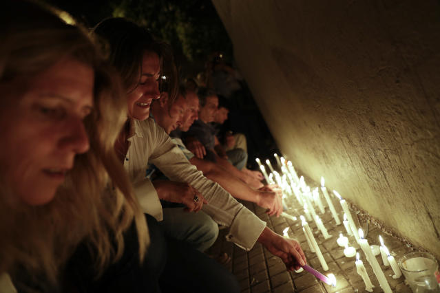 <p>Locals place candles outside the Polytechnic School during a vigil in Rosario, Argentina, Wednesday, Nov. 1, 2017. (Photo: Natacha Pisarenko/AP) </p>