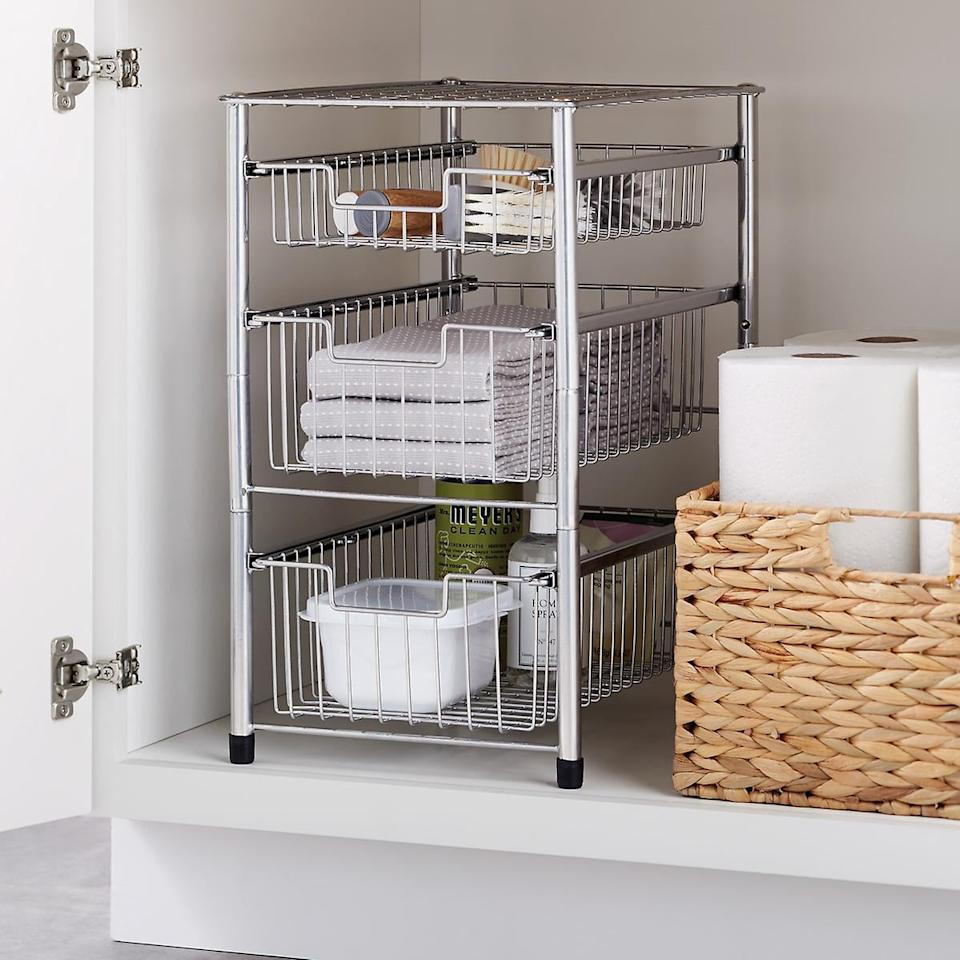 """<p>Keep extra towels and products in this <a href=""""https://www.popsugar.com/buy/Wire-Pull-Out-Cabinet-Organizers-548039?p_name=Wire%20Pull-Out%20Cabinet%20Organizers&retailer=containerstore.com&pid=548039&price=20&evar1=casa%3Aus&evar9=47203882&evar98=https%3A%2F%2Fwww.popsugar.com%2Fphoto-gallery%2F47203882%2Fimage%2F47204448%2FWire-Pull-Out-Cabinet-Organizers&list1=shopping%2Corganization%2Csmall%20space%20living%2Cbathrooms%2Chome%20organization%2Chome%20shopping&prop13=api&pdata=1"""" rel=""""nofollow"""" data-shoppable-link=""""1"""" target=""""_blank"""" class=""""ga-track"""" data-ga-category=""""Related"""" data-ga-label=""""https://www.containerstore.com/s/bath/cabinet-under-sink-storage/wire-pull-out-cabinet-organizers/12d?productId=11011541"""" data-ga-action=""""In-Line Links"""">Wire Pull-Out Cabinet Organizers</a> ($20-$30).</p>"""