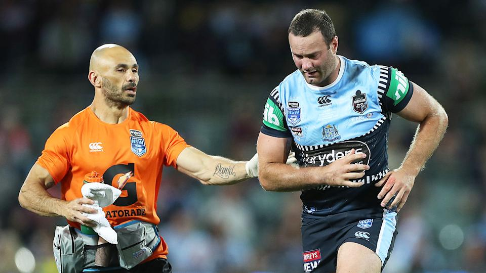 Seen here, Boyd Cordner receives attention after a heavy knock in the State of Origin.