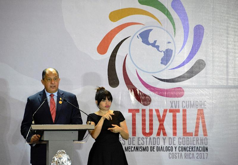 Costa Rica's President Luis Guillermo Solis Rivera said the region faces several problems that need joint action, including migration flows, human rights, organized crime and climate change (AFP Photo/Ezequiel Becerra)
