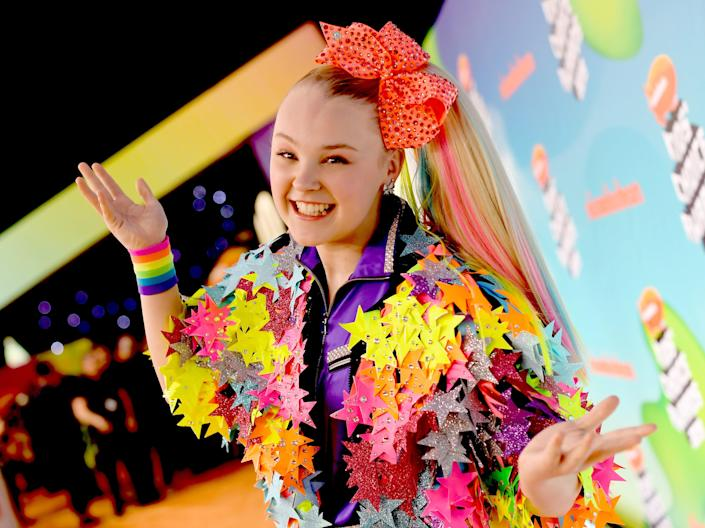 JoJo Siwa says discarding her trademark hair bow was 'harder' than coming out to her mother (Getty Images)