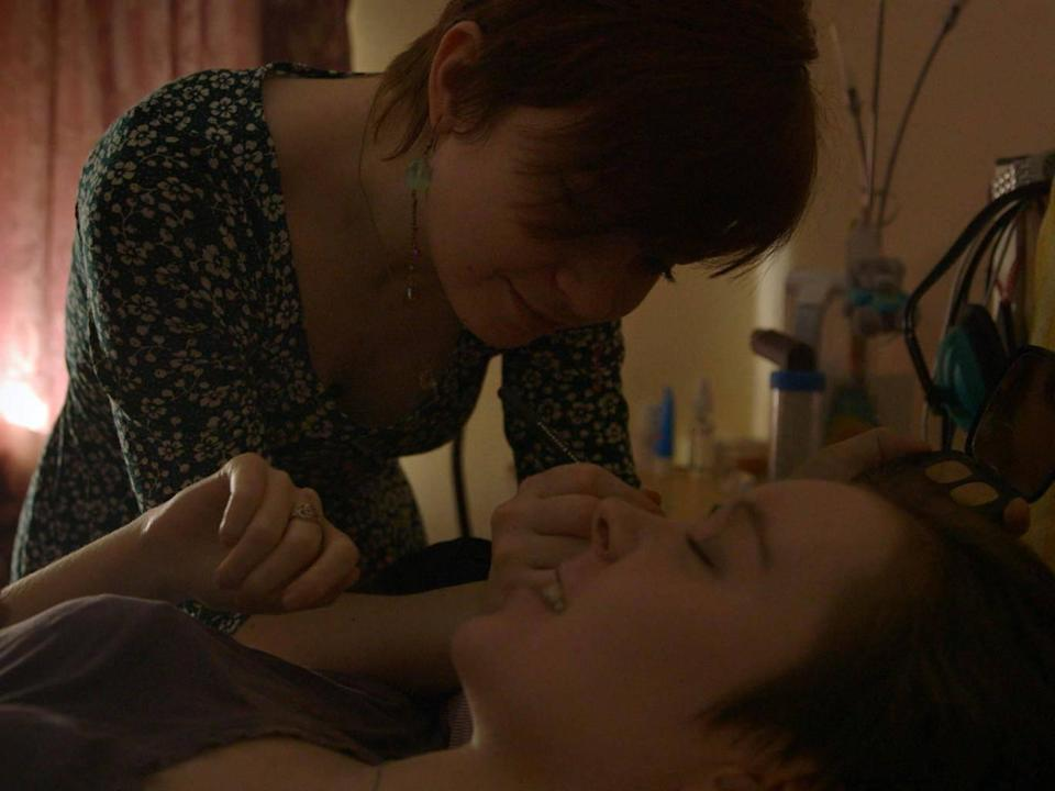 Jessica Taylor, bedridden with severe ME since she was 15, has her makeup done by her sister (Shella Films)