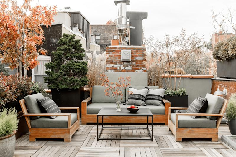 """Pre-renovation, the terrace was just a tar pit. Tierney transformed it into an urban oasis with teak RH couches and plantings by the landscape designer John Wysocki. """"You can see the Empire State Building from up there, which always warms my heart,"""" she says."""