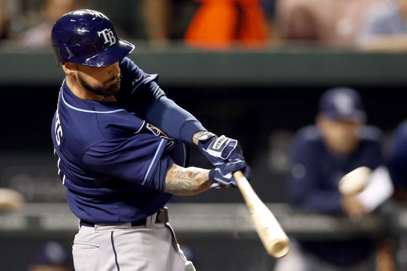 Tampa Bay Rays' Ryan Roberts hits a solo home run in the third inning of a baseball game against the Baltimore Orioles in Baltimore, Tuesday, Sept. 11, 2012. (AP Photo/Patrick Semansky)