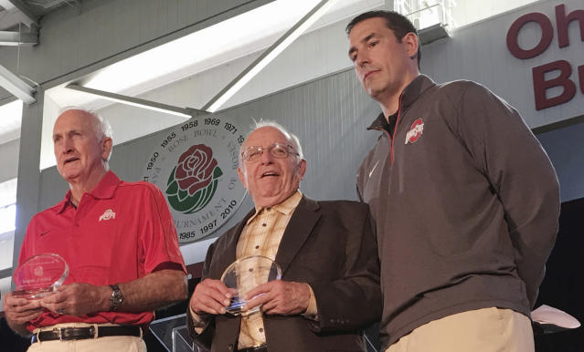 "CORRECTS TO EARLE, NOT EARL AS ORIGINALLY SENT - FILE - In this April 15, 2016, file photo, former Ohio State football coach Earle Bruce is flanked by former Ohio State football coaches John Cooper, left, and Luke Fickell, at a high school coaches clinic in Columbus, Ohio. Former Ohio State football coach Earle Bruce has died at his home in central Ohio. The College Football Hall of Fame member was 87. His four daughters released a statement Friday, April 20, 2018, on the loss of ""a wonderful husband, father, grandfather and a respected coach to many.""(AP Photo/Mitch Stacy, File)"