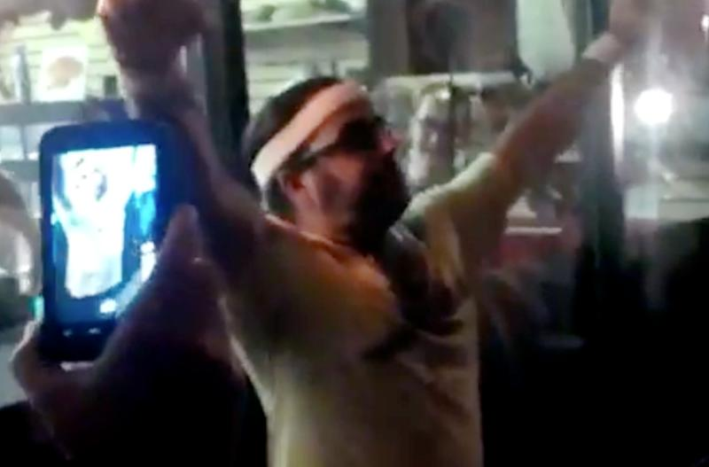 In this frame grab made from video on Friday, Oct. 5, 2012, and provided by John-Patrick McNown, Edward Archbold celebrates winning a roach-eating contest at Ben Siegel Reptile Store in Deerfield Beach, Fla. Archbold, 32, died shortly after downing dozens of the live bugs as well as worms, authorities said Monday, Oct. 8. Authorities were waiting for results of an autopsy to determine a cause of death. (AP Photo/Courtesy John-Patrick McNown)