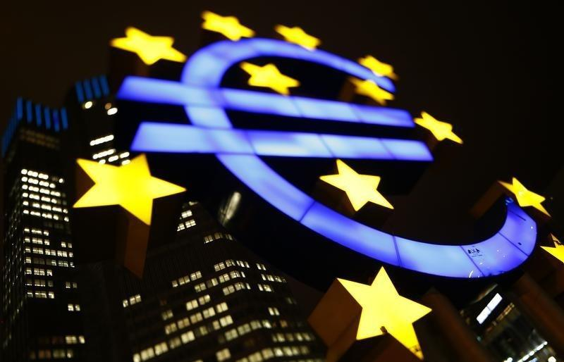 An illuminated euro sign is seen in front of the headquarters of the European Central Bank in Frankfurt