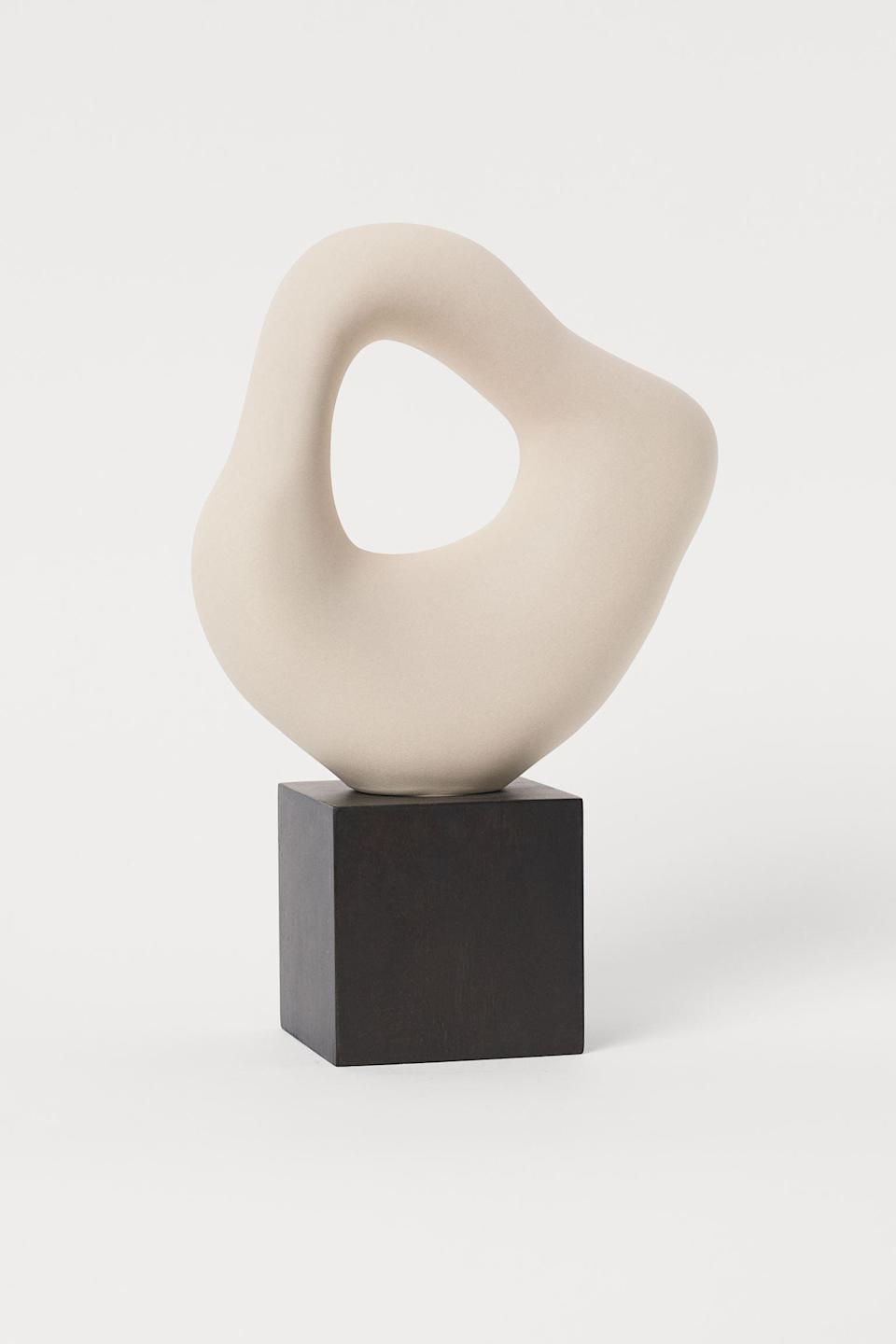 <p>This <span>Large Stoneware sculpture</span> ($35) will add visual interest to a credenza, your living room table, or your office desk. It's definitely attention-grabbing.</p>