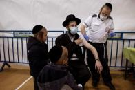 An ultra-Orthodox Jewish man receives a vaccination against the coronavirus disease (COVID-19) at a temporary vaccination centre in the Jewish settlement of Beitar Illit, in the Israeli-occupied West Bank