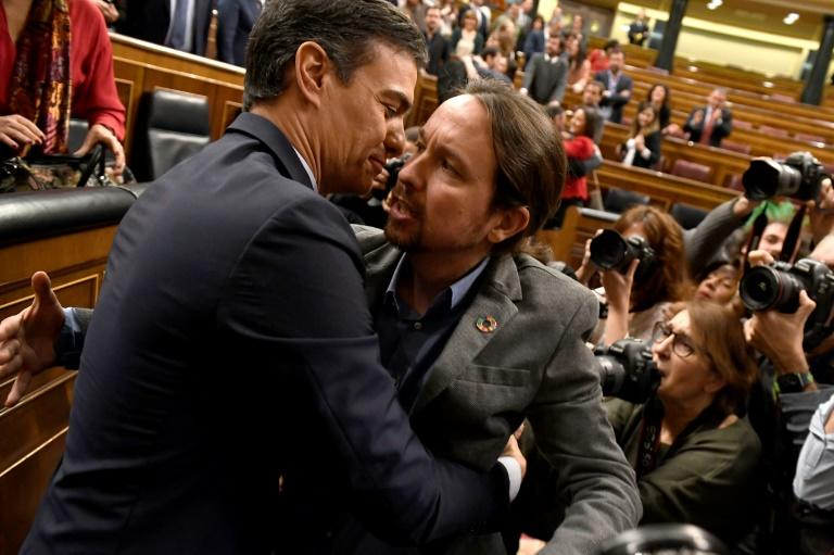 After months of squabbling which ended in a fourth election, Socialist leader Pedro Sanchez and Podemos' Pablo Iglesias finally reached agreement, although it is something of an awkward embrace (AFP Photo/PIERRE-PHILIPPE MARCOU)