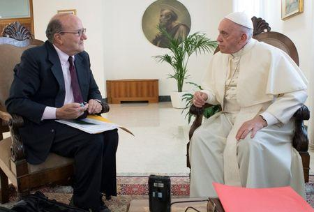 Pope Francis talks during an exclusive interview with Reuters at the Vatican