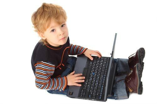 Young child with laptop