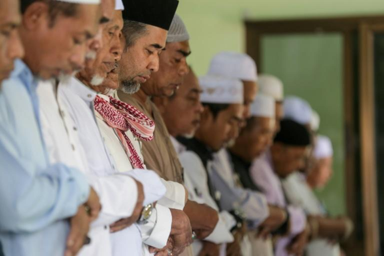 Prayers were held for rebel suspect Abdulloh Esormusor at a mosque in southern Thailand on August 24, 2019, before he died the following morning (AFP Photo/TUWAEDANIYA MERINGING)