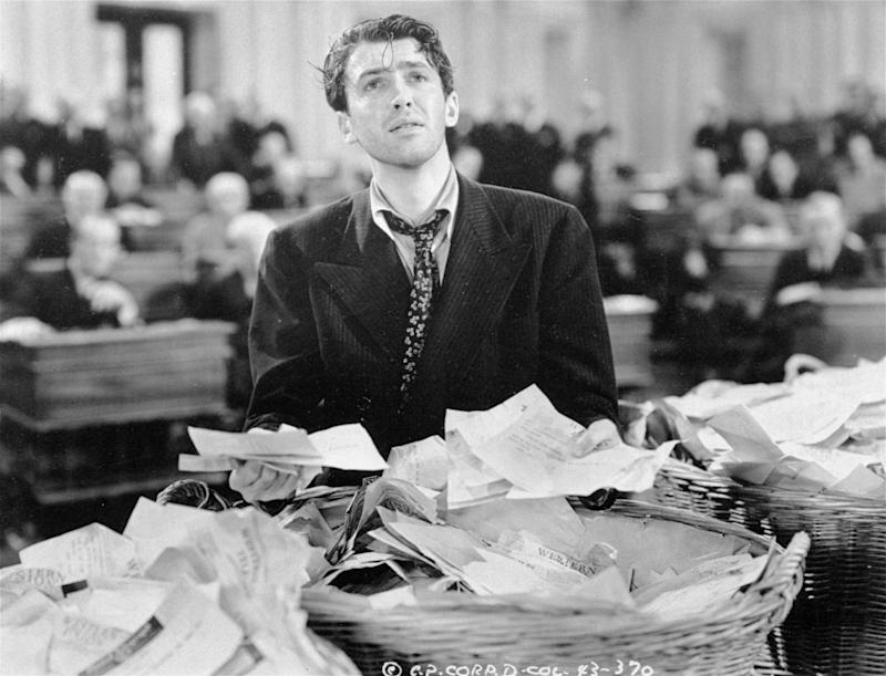 """FILE - This undated black-and-white file photo provided by Columbia shows James Stewart in a scene from the movie: """"Mr. Smith Goes to Washington"""".  The Senate has more filibusters than ever these days. But you'd hardly know it by watching the chamber on C-SPAN. Filibusters are procedural delays that outnumber lawmakers, used to try killing bills and nominations. They seldom look like the exhausted talkathon waged by the devoted senator portrayed by Stewart in the film, """"Mr. Smith Goes to Washington."""" Instead, lawmakers intent on killing a bill simply inform majority Democrats that to pass the measure, they will need yes votes from 60 of the 100 senators. With Democrats controlling just 55 votes, nothing can pass without at least some Republican support. A tentative agreement Thursday between party leaders would curb the use of filibusters a bit, but still let the minority party force majorities to get 60 votes to prevail. (AP Photo/Columbia, File)"""