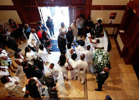 Family members pay their last respects during the funeral for police shooting victim Keith Lamont Scott at the First Baptist Church in James Island, South Carolina, U.S. October 14, 2016. REUTERS/Randall Hill