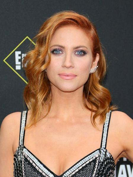 Metallic eyeshadow, a frosted pink lip and a head full of glossy waves ensured that Brittany Snow positively glowed on the red carpet