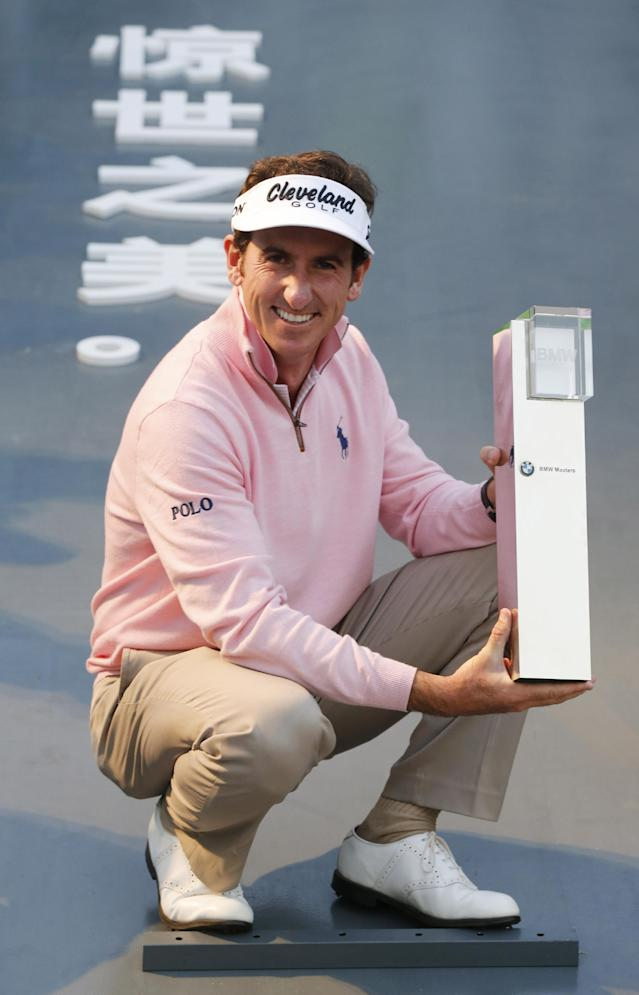 Spain's Gonzalo Fernandez-Castano holds his champion trophy during the award ceremony of the BMW Masters golf tournament at the Lake Malaren Golf Club in Shanghai, China, Sunday, Oct. 27, 2013. Fernandez-Castano finished on 11-under 277, one shot clear of Francesco Molinari (64) and Thongchai Jaidee (66). (AP Photo/Eugene Hoshiko)