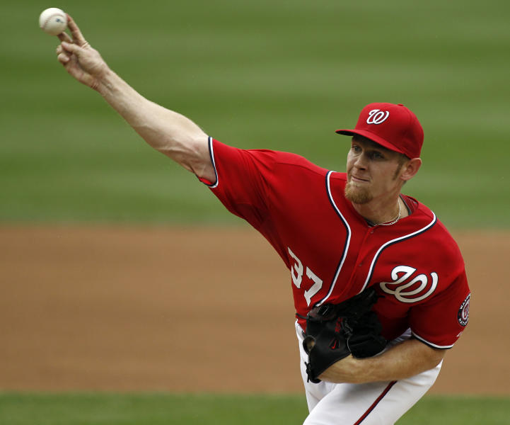 Washington Nationals starting pitcher Stephen Strasburg delievrs during the first inning of a baseball game with the St. Louis Cardinals at Nationals Park, Sunday, Sept. 2, 2012, in Washington. (AP Photo/Alex Brandon)